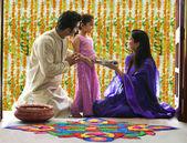 Family making a rangoli — Stock Photo