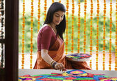 Woman making a rangoli — Stock Photo
