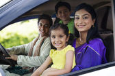 Family sitting inside a car — Stock Photo