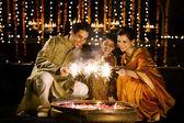 Family celebrating Diwali — Stock Photo