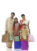 Bengali family with shopping bags — Stock Photo