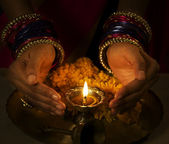 Woman holding a diya — Stock Photo