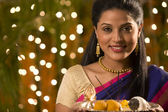 Woman with a tray of diyas — Stock Photo