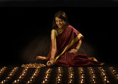 Woman arranging diyas — Stock Photo