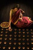 Woman arranging diyas — Stock Photo