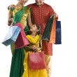 Family with shopping bags — Stock Photo #43788333