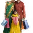 Family with shopping bags — Stock Photo #43788353