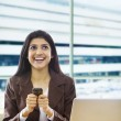 Businesswoman with a mobile phone and laptop — Stock Photo #43789287
