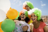 Youngsters with wigs having fun — Stock Photo