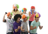 Youngsters with wigs cheering — Stock Photo