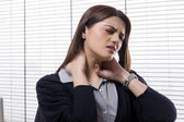Businesswoman with neck ache — Stock Photo