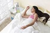 Girl lying in bed — Stock Photo