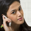 Young woman talking on a mobile phone — Stock Photo #43790607