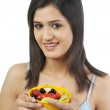 Woman holding a bowl of fruits — Stock Photo #43793755
