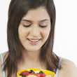 Woman holding a bowl of fruits — Stock Photo #43793833