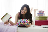 Girl looking at the contents of a gift box — Stock Photo
