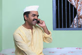 Maharashtrian man talking on a mobile phone — Stock Photo