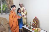 Maharashtrian family praying — Stock Photo