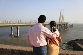 Couple looking at a sea bridge — Stock Photo