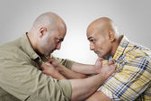 Bald men fighting — Stock Photo