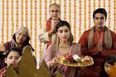 Family arranging diyas — Stock Photo