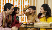 Family opening Diwali gifts — Stock Photo