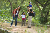 Family in a park — Stock Photo