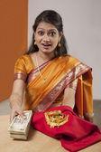 Woman mortgaging her jewelery — Stock Photo