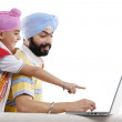 Father and son looking at laptop — Stock Photo #45822581