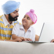 Father and son looking at laptop — Stock Photo #45822595