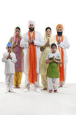Sikh family praying — Stock Photo