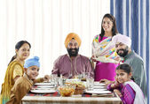 Sikh family having lunch — Stock Photo
