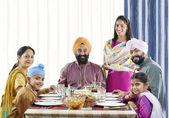 Sikh family having lunch — Stock Photo