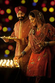 Sikh family with diyas — Stock Photo