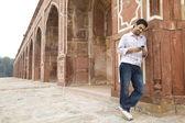Boy looking at an sms at Humayuns Tomb — Stock Photo