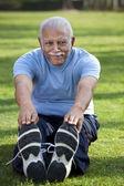 Old man doing exercises — Stock Photo