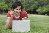 Young man reading text message with laptop — Stock Photo