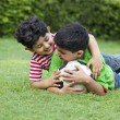 Cheerful brothers playing with soccer ball — Stock Photo