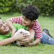 Cheerful brothers playing with soccer ball — Stock Photo #46040199