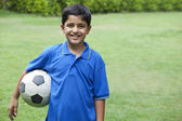 Smiling boy with soccer ball — Stock Photo