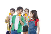 Group of children holding flavored ice — Stock Photo