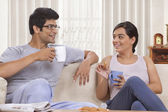 Young couple talking while having coffee — Stock Photo