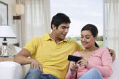 Young couple with cell phone — Stock Photo