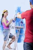 Young couple paiting the wall — Stock Photo
