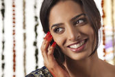 Indian bride talking on a mobile phone — Stock Photo