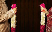 Indian bride and groom holding garlands — Stock Photo