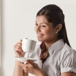 Young businesswoman taking a coffee break — Stock Photo #46052893