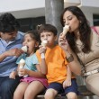 Family eating ice cream — Stock Photo #46057629