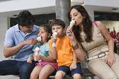 Family  eating ice cream — Stock Photo