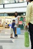 Happy family in shopping mall — Stock Photo